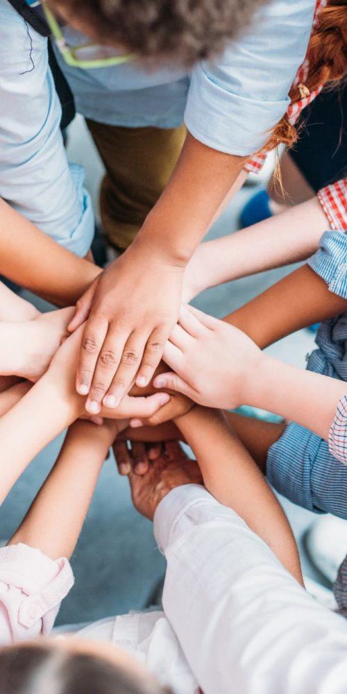 kids-making-team-gesture-Q37323R